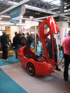 Photo of red Ocean Cycles Challenger with front opening canopy