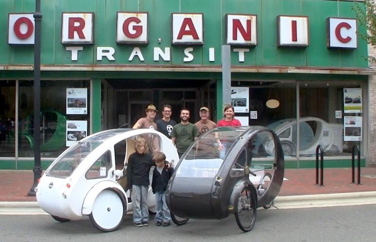 Photo of ELF velomobile and staff outside Organic Transit's premises
